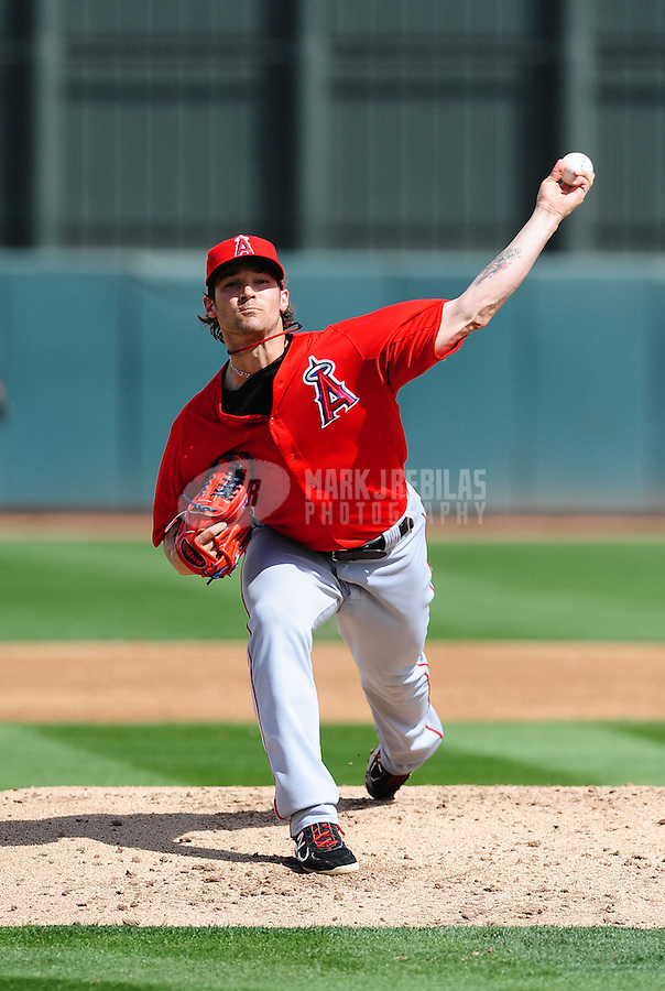 Mar. 4, 2012; Phoenix, AZ, USA; Los Angeles Angels pitcher C.J. Wilson throws in the second inning against the Oakland Athletics during a spring training game at Phoenix Municipal Stadium.  Mandatory Credit: Mark J. Rebilas-