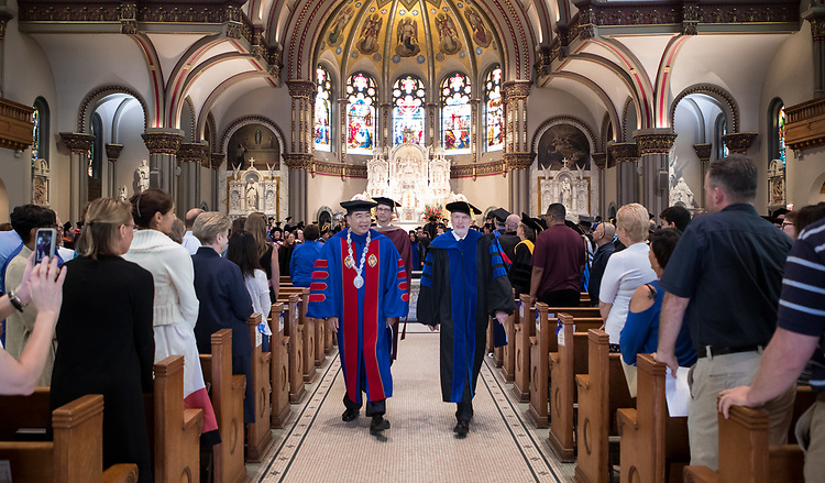 A. Gabriel Esteban, Ph.D., president, left, and Marten denBoer, provost, process out of the St. Vincent de Paul Parish Church after the 120th DePaul University Convocation on Thursday, August 31, 2017. During the ceremony many faculty and staff were recognized with annual awards including: Excellence in Teaching, Spirit of Inquiry, Excellence in Public Service, Vincent de Paul Professorship, Spirit of DePaul, Staff Quality Service, Gerald Paetsch Academic Advising and faculty promotion and tenure. (DePaul University/Jeff Carrion)