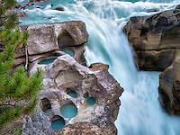 Potholes carved by river. Lower Sunwapta Falls. Jasper National Park, Alberta, Canada