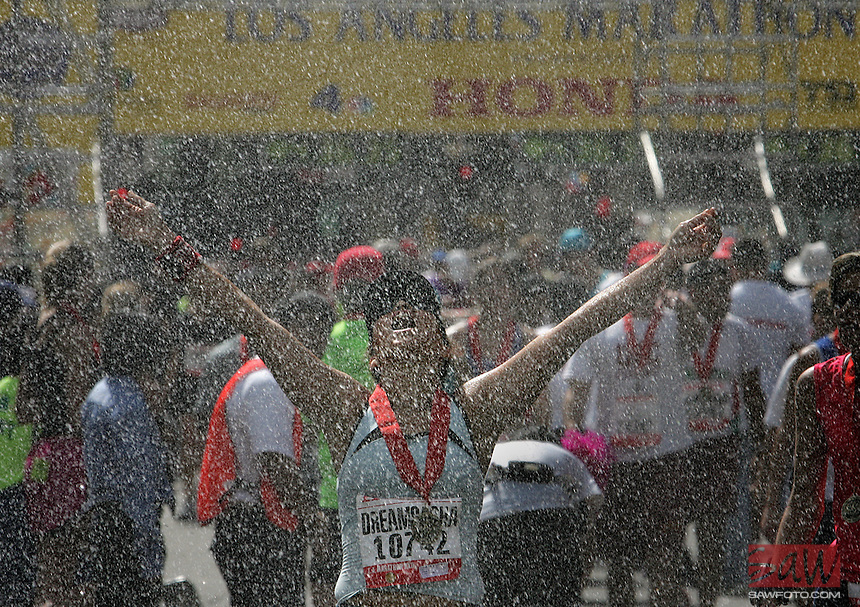 Elva Rodriguez of Riverside is overjoyed to finish the 22nd Annual Los Angeles Marathon.