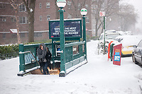 Pedestrians exit the subway in the Chelsea neighborhood of New York on Tuesday, March 14, 2017. Originally predicted as a blizzard with up to 20 inches of snow the storm has changed its course and only 4 to 6 inches of snow, sleet and rain are expected, accompanied by howling winds of course. (© Richard B. Levine)