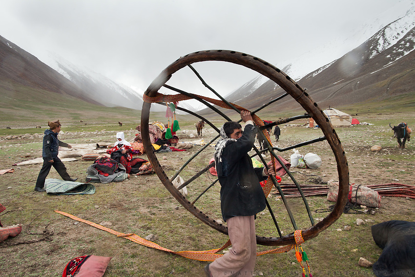 The Khan's family is setting up the yurt's centerpiece. Each Kyrgyz settlement migrates between two and four times a year, depending on the weather and the availability of grass for the animals. The grass at winter camp requires every day of the brief growing season to renew...Moving with the Khan (chief) family from the Qyzyl Qorum camp to the summer camp of Kara Jylga, on the south side of the wide Little Pamir plateau...Trekking through the high altitude plateau of the Little Pamir mountains (average 4200 meters) , where the Afghan Kyrgyz community live all year, on the borders of China, Tajikistan and Pakistan.