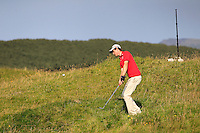 Tim Harry (WAL) in the rough on the 14th during the Afternoon Singles between Ireland and Wales at the Home Internationals at Royal Portrush Golf Club on Thursday 13th August 2015.<br /> Picture:  Thos Caffrey / www.golffile.ie