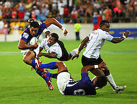 Samoa's Rupena Levasa escapes the flying tackle of Fiji's Jiuta Lutumailagi in the Cup final. IRB Wellington Sevens - Day Two at Westpac Stadium, Wellington. Saturday, 6 February 2010. Photo: Dave Lintott / lintottphoto.co.nz