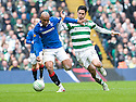 :: RANGERS' EL HADJI DIOUF HOLDS OFF CELTIC'S BERAM KAYAL ::