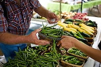 Wall Street Journal reporter Ana Campoy (cq, right) and farmer Jack Finley (cq) of Finley Farms a basket of green beans to be used for canning during a canning class at the White Rock Lake Farmers Market in Dallas, Texas, USA, Saturday, Sept. 12, 2009. Growing produce or buying locally grown vegetables and canning at home is a fun and healthy way to keep grocery costs down...CREDIT: Matt Nager for The Wall Street Journal