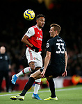 Arsenal's Pierre-Emerick Aubameyang tussles with Brighton's Dan Burn during the Premier League match at the Emirates Stadium, London. Picture date: 5th December 2019. Picture credit should read: David Klein/Sportimage