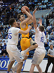 February 4, 2017:  Wyoming guard, Jeremy Lieberman #11, drives for the basket during the NCAA basketball game between the Wyoming Cowboys and the Air Force Academy Falcons, Clune Arena, U.S. Air Force Academy, Colorado Springs, Colorado.  Wyoming defeats Air Force 83-74.
