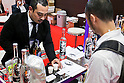 An exhibitor offers samples of his products to visitors at the Mexico booth during the 41st International Food and Beverage Exhibition (FOODEX JAPAN 2016) on March 8, 2016, Chiba, Japan. 3,000 exhibitors from 78 nations are showcasing their products in Asia's largest food and beverage trade show held at Makuhari Messe. This year organisers expect 75,000 visitors during the four day show from March 8 to 11. (Photo by Rodrigo Reyes Marin/AFLO)