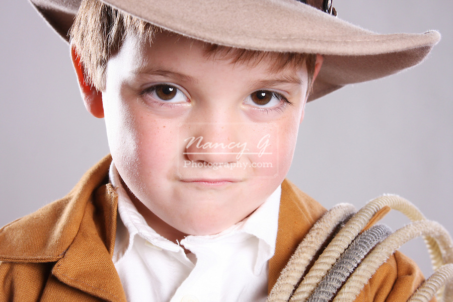 A young cowboy child