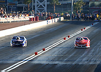 Mar 28, 2014; Las Vegas, NV, USA; NHRA pro stock driver Jason Line (left) races alongside Shane Gray during qualifying for the Summitracing.com Nationals at The Strip at Las Vegas Motor Speedway. Mandatory Credit: Mark J. Rebilas-