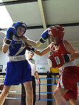 Michael Stokes (in blue) from Holy Family boxing Club and Paul Loonam from St Cartages Boxing Club in action in the Louth Meath Boxing Championships held in Holy Family Boxing Club Ballsgrove.  Photo:Colin Bell/pressphotos.ie