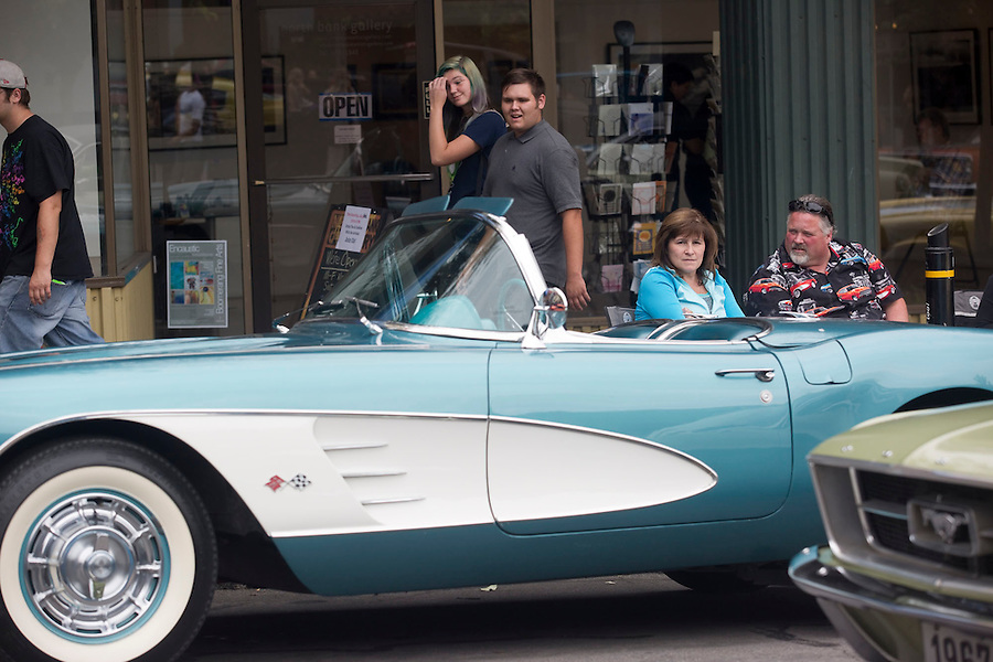 "Terry Overton (R), displays his corvette on Main Street in downtown Vancouver Saturday July 16, 2016. ""Cruisin' the Gut""  is an annual event in which antique car enthusiasts drive up and down main street,. (Photo by Natalie Behring/ for the The Columbian)"