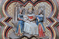 The circumcision of St John, plaque on the North side of the Gothic choir screen, 1490-1530, commissioned by canon Adrien de Henencourt and made by the sculptor Antoine Ancquier, depicting the life of St John the Baptist, at the Basilique Cathedrale Notre-Dame d'Amiens or Cathedral Basilica of Our Lady of Amiens, built 1220-70 in Gothic style, Amiens, Picardy, France. Amiens Cathedral was listed as a UNESCO World Heritage Site in 1981. Picture by Manuel Cohen