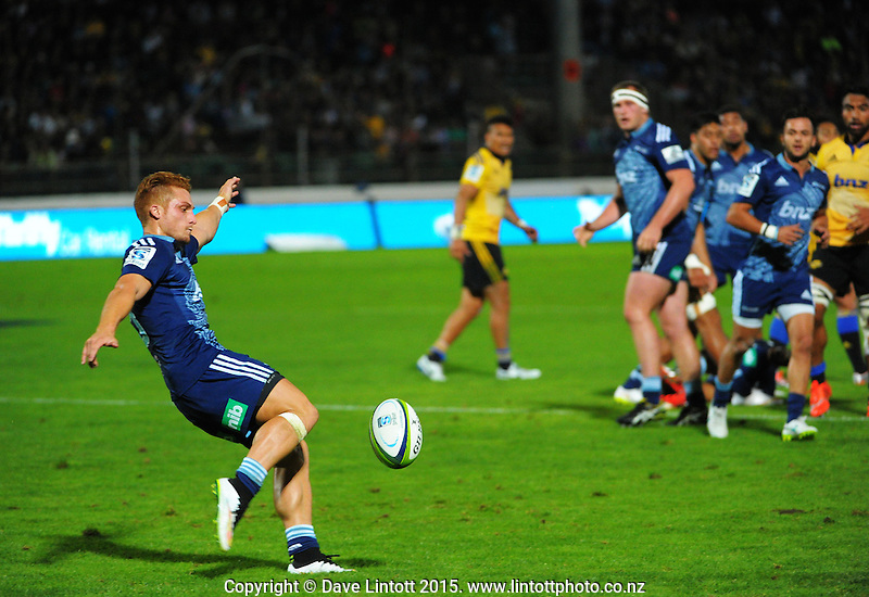 Ihaia West clears during the Super Rugby match between the Hurricanes and Blues at FMG Stadium, Palmerston North, New Zealand on Friday, 13 March 2015. Photo: Dave Lintott / lintottphoto.co.nz