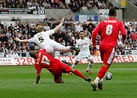 Pictured: Alan Tate of Swansea tackled by david McGoldrick in the first half<br />