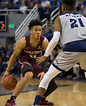 Little Rock guard Jaizec Lottie (11) is guarded by Nevada's forward Jordan Brown (21) in the first half of an NCAA college basketball game in Reno, Nev., Friday, Nov. 16, 2018. (AP Photo/Tom R. Smedes)