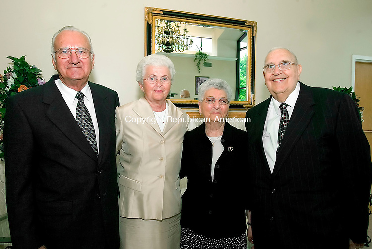 WATERTOWN, CT-27 AUGUST 2006-082706JS04-Ray Misura of Watertown and his wife Lillian Misura with Dolores Granatuk of Waterbury and her husband Michael Granatuk, Chairman of the  100th Anniversary Committee, at the St. Mary's Orthodox Church's 100th anniversary dinner at the Grand Oak Villa in Watertown. -Jim Shannon Republican-American