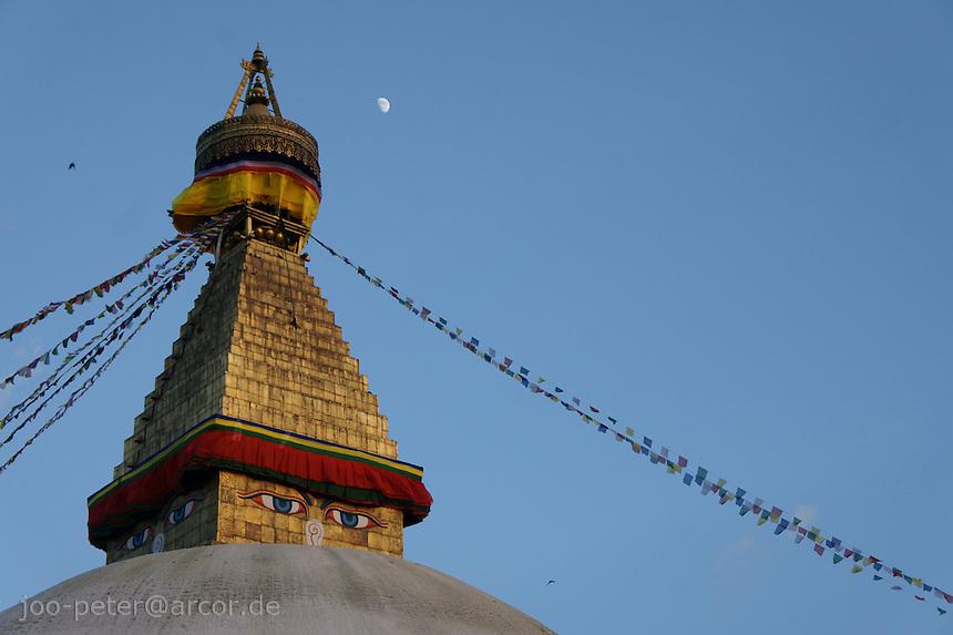 top of Boudha stupa in Kathmandu, Nepal, close up - Boudhanath near Kathmandu is one of the most holy places of buddhist worship and pilgrimage. The ancient Stupa is one of the largest in the world.