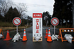 A sign warns people that entrance is prohibited into the 20 km exclusion zone in Minami-Soma, Fukushima Prefecture, Japan on 30 March, 2011.  Photographer: Robert Gilhooly