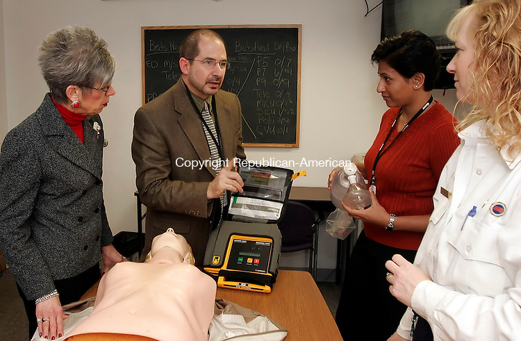WATERBURY, CT24 January 2006-012406TK05 (left to right:)   At the Waterbury Hospital, Ralph Miro, Emergency Medical Services Coordinator of Emergency Department, along with, Carol Graziosa(left), Deepa Bangalore, and Judy Lynch(right), participate in a Automatic Electronic Defribulator presentation.  Tom Kabelka / Republican-American (Carol Graziosa, Deepa Bangalore, Judy Lynch)CQ