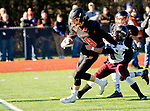 WATERTOWN, CT-112317JS12- Watertown's Thomas Hassan (8) fights off a tackle attempt by Torrington's Starling Santos (40) to score a touchdown during their Thanksgiving Day game Thursday at Watertown High School. <br /> Jim Shannon Republican-American