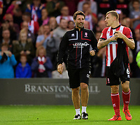 Lincoln City manager Danny Cowley, left, with Lincoln City's Harry Anderson before kick off<br /> <br /> Photographer Chris Vaughan/CameraSport<br /> <br /> The Carabao Cup Second Round - Lincoln City v Everton - Wednesday 28th August 2019 - Sincil Bank - Lincoln<br />  <br /> World Copyright © 2019 CameraSport. All rights reserved. 43 Linden Ave. Countesthorpe. Leicester. England. LE8 5PG - Tel: +44 (0) 116 277 4147 - admin@camerasport.com - www.camerasport.com