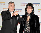 Washington, DC - December 5, 2009 -- Fred Rappoport gestures towards one of the photographers as he and his wife, Michelle Lee,  arrive for the formal Artist's Dinner at the United States Department of State in Washington, D.C. on Saturday, December 5, 2009..Credit: Ron Sachs / CNP.(RESTRICTION: NO New York or New Jersey Newspapers or newspapers within a 75 mile radius of New York City)
