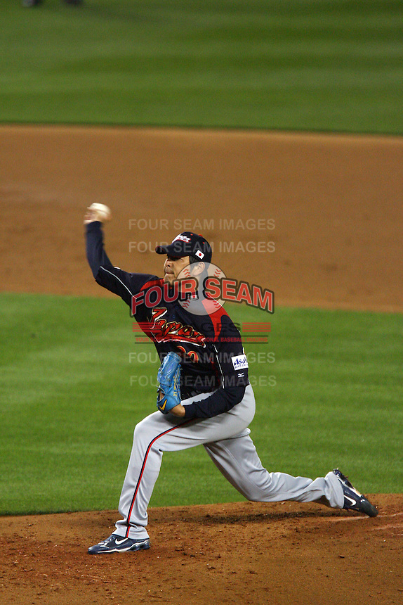Hisashi Iwakuma of Japan during a game against Korea at the World Baseball Classic at Dodger Stadium on March 23, 2009 in Los Angeles, California. (Larry Goren/Four Seam Images)