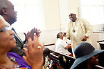 Reverend Dr. Gerald L Durley preaches health to his congregation. His congregation honored him during the service August 15, 2010 in celebration of Rev. Dr. Durley's 23rd pastoral anniversary at Providence Missionary Baptist Church. He greets members of the congregation during the service.