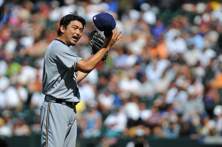 17 JULY 2011: Milwaukee Brewers relief pitcher Takashi Saito (40) pleads with a fan who was yelling his first name during the pitcher's delivery during a regular season game between the Milwaukee Brewers and the Colorado Rockies at Coors Field in Denver, Colorado. The Brewers beat the Rockies 4-3 to split the four game series. *****For Editorial Use Only*****
