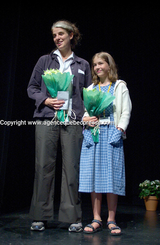 August 29,  2002, Montreal, Quebec, Canada<br /> <br /> Anne Wild, Film Maker (L)<br /> Henriette Confurius, 11year old actress (R)<br /> Anne Wild, Film Maker (L)<br /> on stage at the Maisonneuve Theater of the PLACE DES ARTS in Montreal Canada<br /> , before the screening of Wild's movie<br /> MEIN ERSTES WUNDER (My First Miracle), presented in the official competitionof the 26th World Film Festival, August 29, 2002<br /> <br /> Born in Offenburg, Germany in 1967, Anne Wild studied literature, philosophy and art history at the University of Freiburg and acting at the Academy of Music and Applied Arts in Stuttgart. In the mid-1990s she worked in advertising in Hamburg and Berlin, then studied screenwriting and directing. Since 1997 she has worked as a freelance journalist for newspapers, radio and television. She wrote the script for WAS TUN, WENN'S BRENNT? (2002) and directed Afternoon in Siedlisko (2000) and Ballett ist ausgefallen (2001). MY FIRST MIRACLE marks her directorial debut in features. <br /> , LUCIE AUBRAC (Claude Berri, 1997), THE COMEDIAN HARMONISTS (Joseph Vilsmaier, 1997), and two by Tom Tykwer, WINTERSLEEPERS (1997) and RUN, LOLA, RUN (1998). He starred in Roland Suso Richter's hit film THE TUNNEL (2001), winner of the audience award at last year's Montreal World Film Festival, and his most recent film, THE SEAGULL'S LAUGHTER, is also showing at this year's Festival. He represents the new wave of german actors. <br /> <br /> <br /> Mandatory Credit: Photo by Pierre Roussel- Images Distribution. (&copy;) Copyright 2002 by Pierre Roussel <br /> <br /> NOTE : <br />  Nikon D-1 jpeg opened with Qimage icc profile, saved in Adobe 1998 RGB<br /> .Uncompressed  Uncropped  Original  size  file availble on request.