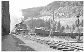 D&amp;RGW #499 heading up a RMRRC excursion at Monarch.  The engine has been turned for the return to Salida.  There is a string of loaded gondolas on departure track.<br /> D&amp;RGW  Monarch Branch, CO  Taken by Pfeifer, Jack A. - 9/25/1949