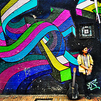 A Colombian street musician stands in front of a graffiti artwork, created by an artist named Zas, in La Candelaria, Bogotá, Colombia, 18 February, 2016. A social environment full of violence and inequality (making the street art an authentic form of expression), with a surprisingly liberal approach to the street art from Bogotá authorities, have given a rise to one of the most exciting and unique urban art scenes in the world. While it's technically not illegal to scrawl on Bogotá's walls, artists may take their time and paint in broad daylight, covering the walls of Bogotá not only in territory tags and primitive scrawls but in large, elaborate artworks with strong artistic style and concept. Bogotá has become an open-air gallery of contemporary street art.