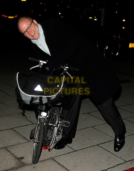 TOBY YOUNG .At the Evening Standard Influentials Party, Altitude 360, Millbank Tower, London, England, UK, .16th November 2010..full length black suit bike leaning over bicycle glasses .CAP/CAN.©Can Nguyen/Capital Pictures.