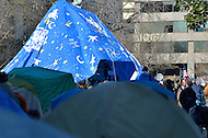 January 30, 2012  (Washington, DC)  OccupyDC protestors gathered under a large blue tarp at McPherson Square, anticipating a police raid and eviction that did not come by the noon deadline imposed by the National Park Service.  (Photo by Don Baxter/Media Images International)