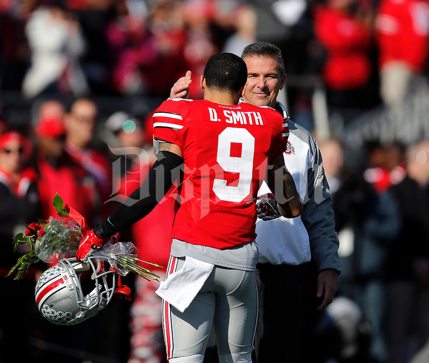 Ohio State Buckeyes head coach Urban Meyer greets Ohio State Buckeyes wide receiver Devin Smith (9) prior to the NCAA football game against Michigan at Ohio Stadium on Saturday, November 29, 2014. (Columbus Dispatch photo by Jonathan Quilter)