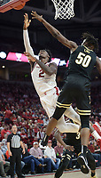 Arkansas forward Adrio Bailey reaches to score Wednesday, Jan. 15, 2020, over Vanderbilt wing Ejike Obinna (50) during the second half in Bud Walton Arena. Check out nwaonline.com/photos for a gallery from the game. (NWA Democrat-Gazette/Andy Shupe)