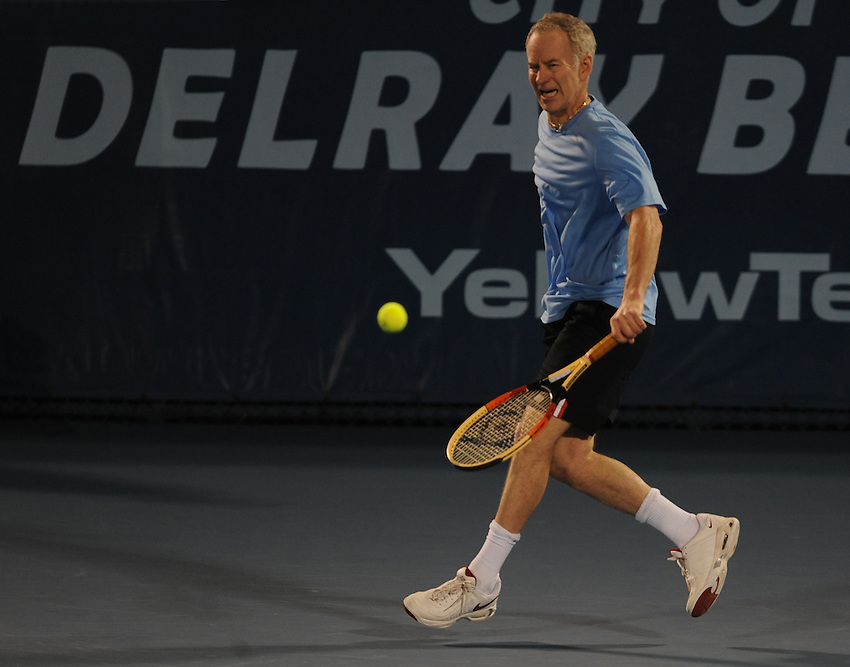 John McEnroe in action against Todd Martin during their Group A match..