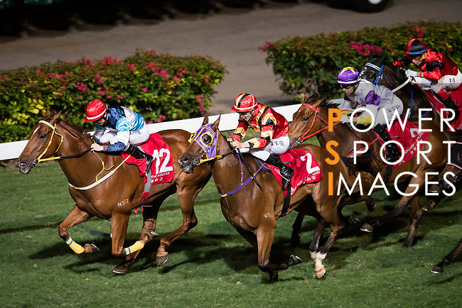 Jockey #2 Derek Leung Ka-chun riding Fortune Bo Bo (C) on the race 6 during Hong Kong Racing at Happy Valley Race Course on December 06, 2017 in Hong Kong, Hong Kong. Photo by Marcio Rodrigo Machado / Power Sport Images