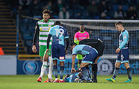 Players and referee gather around injured Anthony Stewart of Wycombe Wanderers during the Sky Bet League 2 match between Wycombe Wanderers and Yeovil Town at Adams Park, High Wycombe, England on 14 January 2017. Photo by Andy Rowland / PRiME Media Images.