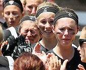 Losing, its said, builds character. However, that adage didn't make it any easier for the Troy Colt softball team who agonized over the heartbreaking 5-4 regional semi-final loss to Lake Orion at Hartland High School Saturday, June 7, 2014.