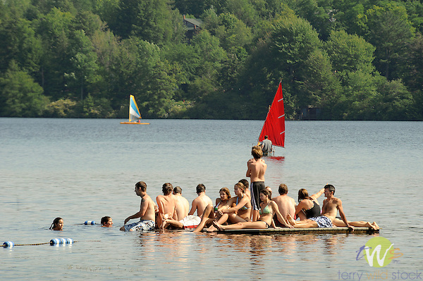 Eagles Mere Lake float loaded with teenagers.