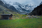 Wooden storage cabin against snow capped mountains, Imst district, Tyrol, Tirol, Austria.
