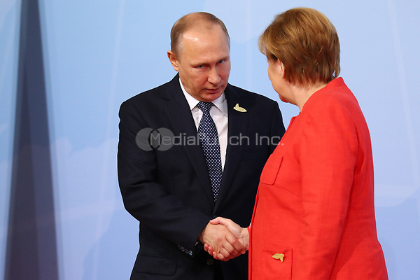 German chancellor Angela Merkel greets the Russian president Vladimir Putin at the G20 summit in Hamburg, Germany, 7 July 2017. The heads of the governments of the G20 group of countries are meeting in Hamburg on the 7-8 July 2017. Photo: Bernd Von Jutrczenka/dpa-pool/dpa /MediaPunch ***FOR USA ONLY***