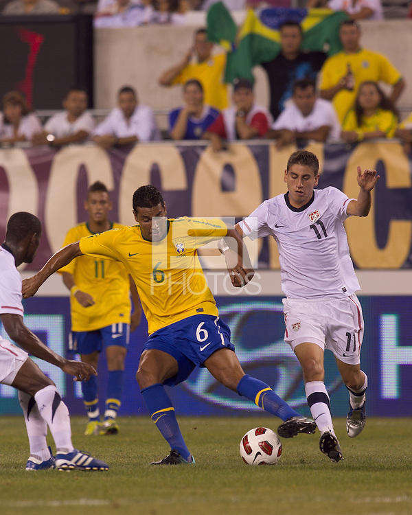 Brazil defender Andre Santos (6) dribbles as USA forward Alejandro Bedoya (11) defends. Brazil  defeated the US men's national team, 2-0, in a friendly at Meadowlands Stadium on August 10, 2010.