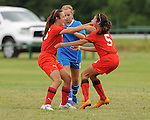 Members of the U-14 Lafreniere Sting celebrate following a goal during the State Championship in Baton Rouge.
