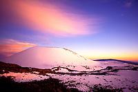 Snowcapped Puu Lilinoe (crater) at 12,987 feet elevation, just below the summit of Mauna Kea