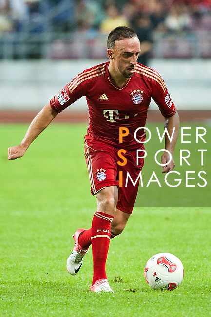 GUANGZHOU, GUANGDONG - JULY 26:  Franck Ribery of Bayern Munich in action during a friendly match against VfL Wolfsburg as part of the Audi Football Summit 2012 on July 26, 2012 at the Guangdong Olympic Sports Center in Guangzhou, China. Photo by Victor Fraile / The Power of Sport Images