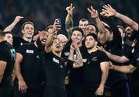 New Zealand players pose for a selfie after the match. Rugby World Cup Final between New Zealand and Australia on October 31, 2015 at Twickenham Stadium in London, England. Photo by: Patrick Khachfe / Onside Images